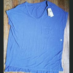 NWT AEO Soft & Sexy Oversized Tee Brand new with tags oversized Soft & Sexy tee by American Eagle Outfitters.  This material feels amazing!  Light weight, v-neck, with small pocket. American Eagle Outfitters Tops Tees - Short Sleeve
