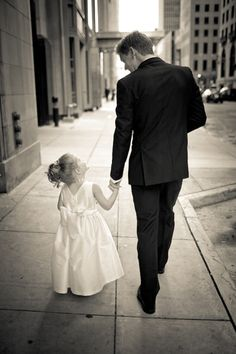 "Why We Love It: We love this precious photo of a groom and his little girl. Why You Love It: ""Such a nice way to show the love between a father and a daughter."" —Carina C. ""This is so awesome!"" — Deborah T. ""Such a heartwarming picture!"" — Diana E. Photo Credit: Robb Davidson Photography"
