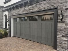 Gray Garage Door for Spanish/Mediterranean style home. Clopay Canyon Ridge Collection faux wood carriage house garage door, Design 12 with opaque long windows, custom-stained gray to match stone exterior. Garage Door Trim, White Garage Doors, Faux Wood Garage Door, Garage Door Colors, Modern Garage Doors, Best Garage Doors, Garage Door Styles, Garage Door Makeover, Garage Door Design