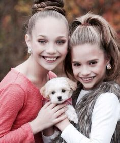 maddie ziegler and Mackenzie Ziegler with there new puppy that abby gave mackenzie for christmas