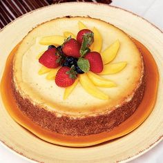 This mango cheesecake gets its golden color and tropical flavor from stirring a mango puree into the cream cheese mixture.