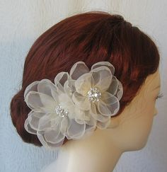 Pale Champagne Hair Flowers Bridal Fascinator by TheRedMagnolia. $52.00, via Etsy.