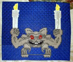 Haunted Mansion gargoyle done in cross stitch on plastic canvas. Took me a month to do.