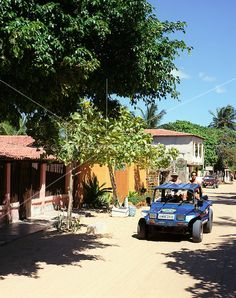 dune buggy drives down the sandy back streets of Jericoacoara, Brazil