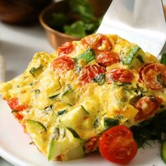 Mozzarella, Basil & Zucchini Frittata - - This vegetable-studded frittata recipe is one of the quickest meals you can make. Make it for breakfast, or serve for lunch or dinner with a tossed salad and a slice of olive oil-drizzled crusty baguette. Healthy Breakfast Recipes, Brunch Recipes, Easy Dinner Recipes, Vegetarian Recipes, Easy Meals, Cooking Recipes, Healthy Recipes, Salad Recipes, Zucchini Frittata