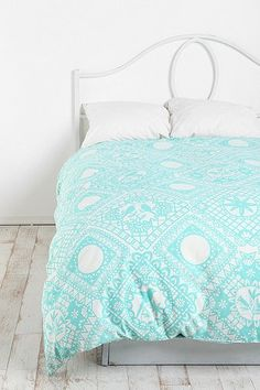 Papercut Duvet / Doona Cover from Urban Outfitters, $89... Like the aqua and the pattern.