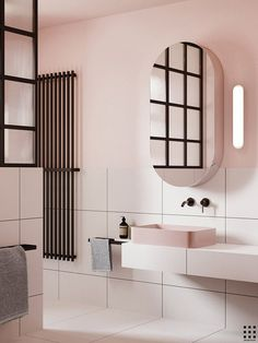 Contemporary bathroom with pink walls and black metal glass shower divider
