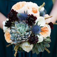 """""""I knew I wanted hydrangeas and ranunculus with some pops of color,"""" Stacy recalls of the bouquets. She carried these flowers along with garden roses, peonies, thistle and succulents."""