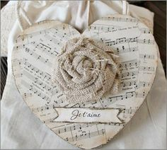 """Burlap rose on music sheet heart with """"Je t'aime"""""""