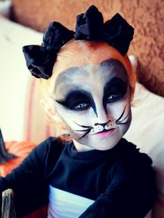 this face paint with red contacts. scary cat Halloween make up Chat Halloween, Fete Halloween, Creepy Halloween, Halloween House, Halloween Makeup, Halloween Contacts, Halloween Activities For Kids, Halloween Costumes For Kids, Black Cat Face Paint