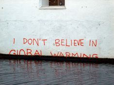Banksy doesn't have to pickax a telephone booth or put an elephant in the room to make this smart point on climate change. he world's most elusive graffiti artist, Banksy, tagged this building. Picture originally found on Green Grown & Sexy.