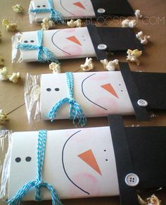 Popcorn or chocolate bar wrapped with snowman or Santa.