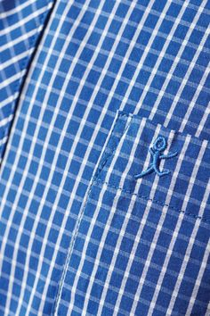 Cut in our classic fit in an iconic Wild South check this lightweight cotton shirt is available in both cobalt blue and navy. Featuring a front chest pocket,and two pleats in the back for extra comfort, the shirt is finished with branded buttons and man embroidery.