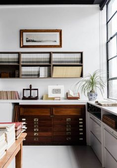 Rare Bookseller' Office Space in Surry Hills by Busatti Studio. Vintage display of books