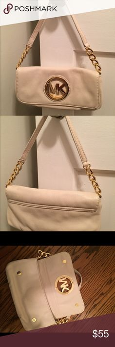 Michael Kors small shoulder bag Michael Kors small shoulder bag in Vanilla (off white) leather with gold hardware. Handle is leather and gold chain. Easily fits phone, keys, and small wallet. Great condition. Michael Kors Bags Shoulder Bags
