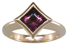 Rhodolite Polaris - January Birthstone  A dramatic, simple design featuring a Princess-cut Rhodolite Garnet set in a hand-crafted 18kt rose gold ring.