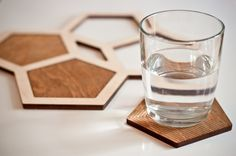 Set of 4 pentagon shaped coasters and one trivet. The coasters are in 1/4'' plywood, they are etched and stained on one side with a geometric pattern and the other side has a natural finish and no etching.The trivet has a natural finish. You can use them individually on a small table or combine them to protect a bigger surface.