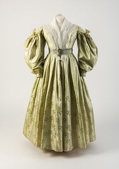 OBJECT 34 - Light green woven silk dress with gigot sleeves, 1835. Fashion Museum Bath.