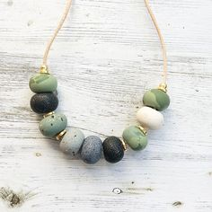 Khaki greens, black and grey handmade necklace, polymer clay necklace, polymer beaded necklace handmade by rubybluejewels by Rubybluejewels on Etsy https://www.etsy.com/au/listing/537518321/khaki-greens-black-and-grey-handmade