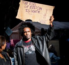 Man with a sign. #occupywallstreet