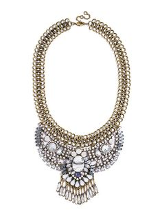 An antique stunner features ornate crystal work and cool blue gemstones. Mixed with a marblesque howlite focal point and delicate crystal fringe, this icy statement is a head turner.