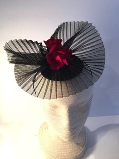 A personal favorite from my Etsy shop https://www.etsy.com/listing/220312776/black-rose-fascinator-flower-headpiece