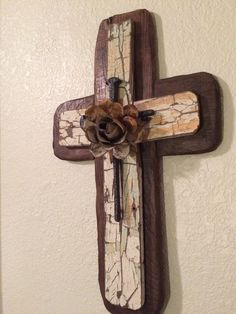 Reclaimed wood cross with a French Country Shabby Chic look. The cast iron cross and  hand cut metal rose were meant for each other! The rose in its crème patina picks up the crackled  patina in the 2nd layer of wood which came from an old ranch/farm house--- left in its aged and beautifully crackled patina.