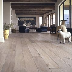 Love these white washed wood floors and high beams
