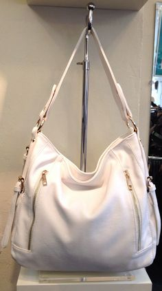 New beautiful white handbag with front and back zipper pockets and animal print lining