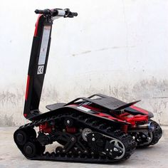 A fantastical blend of skateboard, ATV, and battle tank, the DTV Shredder breaks new ground (literally) in the world of off-road vehicles. Electric Bike Kits, Electric Vehicle, Military Vehicles For Sale, Prosthetic Leg, E Scooter, Battle Tank, Chenille, Sports Activities, Go Kart
