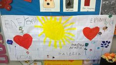 Τα παιδιά ζωγραφίζουν στον τοίχο 2 καρδιές κι έναν ήλιο στη μέση Plastic Cutting Board, November, November Born