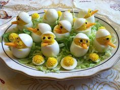 Deviled Eggs with carrot beak and peppercorn eyes