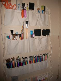 Attach inexpensive 5-Pocket Waist Aprons on the wall to organize your craft supplies