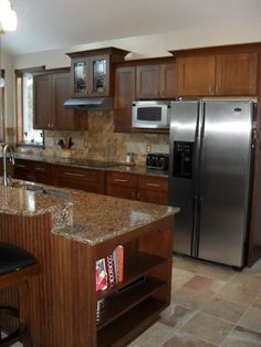 A kitchen in DeWitt, Michigan, was remodeled in two tones of ...