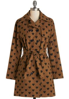 Love to Amble Coat. A dip in the temperature is no reason to hide indoors - especially when you have this heart-printed trench coat to keep you warm! #brown #modcloth