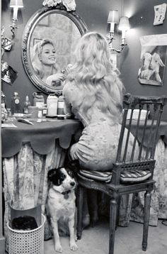Brigitte Bardot at home with her dog Guapa, 1950s