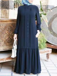 One of our favorite dresses from the collection, this maxi dress combines gorgeous fabric with detailed design elements. Abaya Fashion, Muslim Fashion, Modest Fashion, Fashion Outfits, Hijab Style Dress, Mode Abaya, Abaya Designs, Muslim Dress, Islamic Clothing