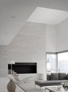 pale grey vein cut travertine walls | contemporary living space || Sofa Charles B Italia