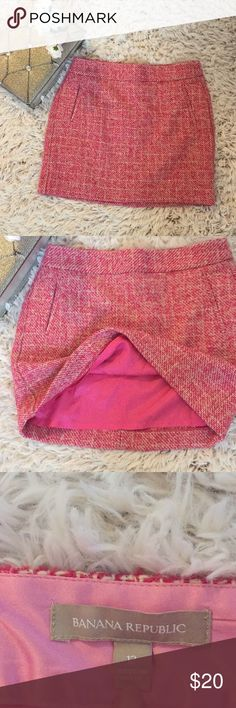 """Banana Republic Parrot Pink Tweed Skirt Parrot Pink and Cream Tweed Like New EUC Midi Skirt.  Two Front Welt Pockets Fully Lined Back Zip w Hook & Eye Closure 18"""" Waistband Laying Flat 17.5"""" Waistband to Bottom of Hem Pair with a Jean Jacket/Tee,/Chucks, Army Jacket/Tights/Boots or a Business Blazer/Blouse/Pumps, the Possibilities are Endless! Banana Republic Skirts Midi"""