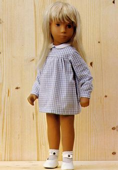 I loved sasha dolls. I still have mine..this blonde one and a dark-haired one. The clothes for them were expensive so my mom bought a pattern book and sewed them outfits!