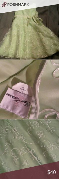 Like new minty green girls dress size 10 worn once Minty green colored sleeveless dress with a bow tie in the front and back Rare Editions Dresses Formal