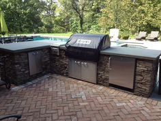 "Matt's dream space- Natural Fieldstone BBQ Enclosure with 42"" Grill, outdoor refrigerator, and trash door.  This space is complete with a bluestone countertop and a brick patio in herringbone pattern.  Cording Landscape Design, NJ #BBQ #outdoorkitchen"