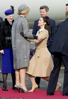 Crown Princess Mary of Denmark curtsies to Queen Maxima at Kastrup Airport in Denmark