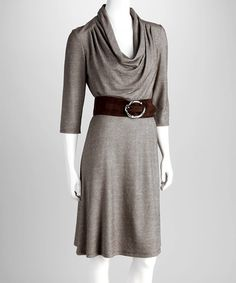 """A brown and white crosshatch pattern deepens the shapely contours of this stately dress. The draped neckline hangs above a broad faux-suede belt finished with a round, polished belt for high-impact sophistication.Includes dress and beltMeasurements (size 6): 41"""" from high point of shoulder to hem55% polyester / 45% rayo..."""
