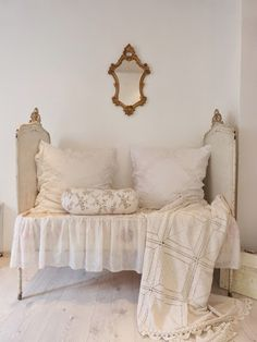 What a pretty vintage daybed!  I love the linens!  Via Heavens Rose Cottage