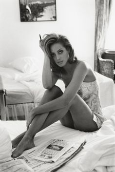 Reading morning paper in the bed. Christy Turlington