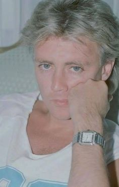 Those eyes! I must count ALL of his eyelashes. Roger, you are simply mouthwatering.