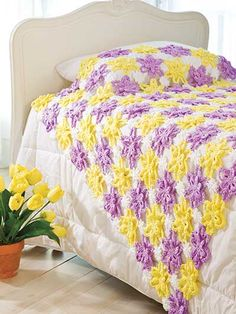 Pretty Posies Throw Crochet Pattern Download from e-PatternsCentral.com -- Beautiful lace flowers in lavender, yellow and white are joined together to create an elegant spring throw.