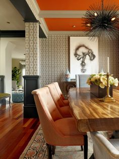 dining room.  jay jeffers.  orange ceiling, gray  graphic wallpaper, amazing light fixture.