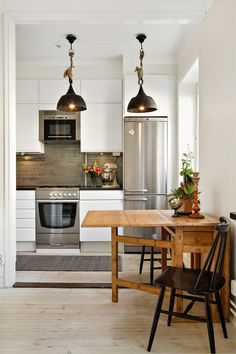 Love this idea of a table that folds in for a small kitchen.